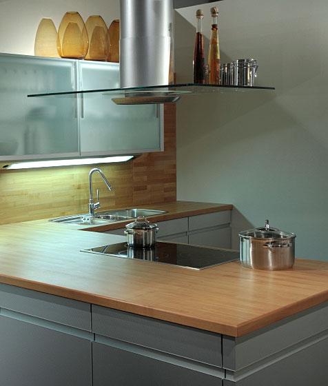butcher block top in a modern, L-shaped kitchen
