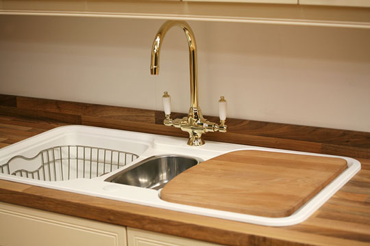 Kitchen Sink With Butcher Block Countertop And Cutting Board