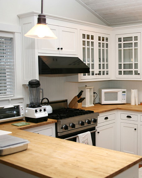 wood, butcher block countertops and white kitchen cabinets